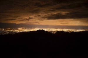 The lights of Tucson illuminate an approaching storm during a night session at the Beaver Wall.  Photo by Alex McIntyre.