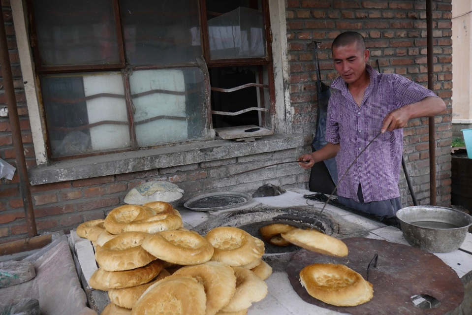 Bread Baker (A Local Kahzahk baker dishing out some Nann) photo ana pautler